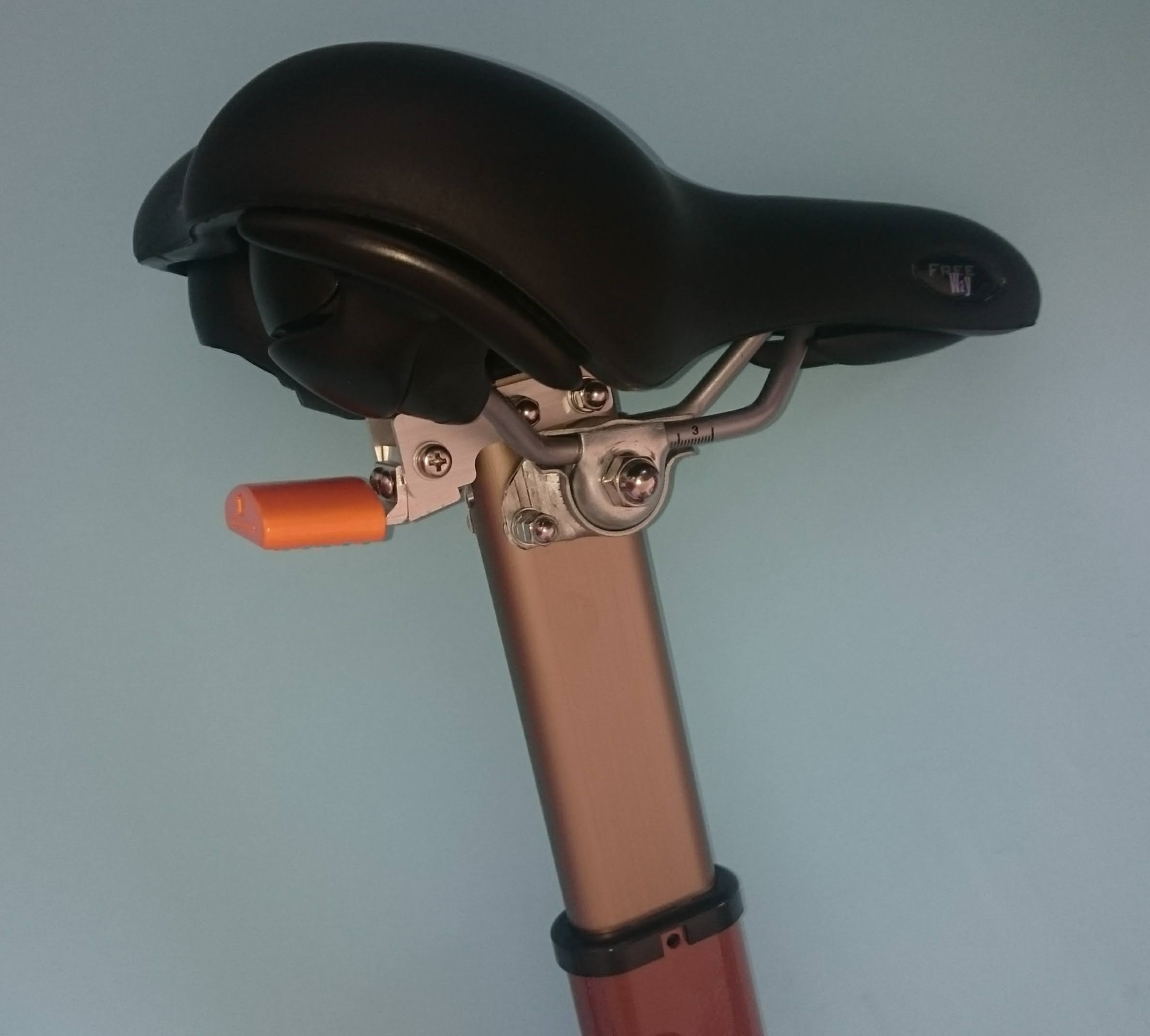 Walking stick and bicycle saddle which had a mechanical adjustment